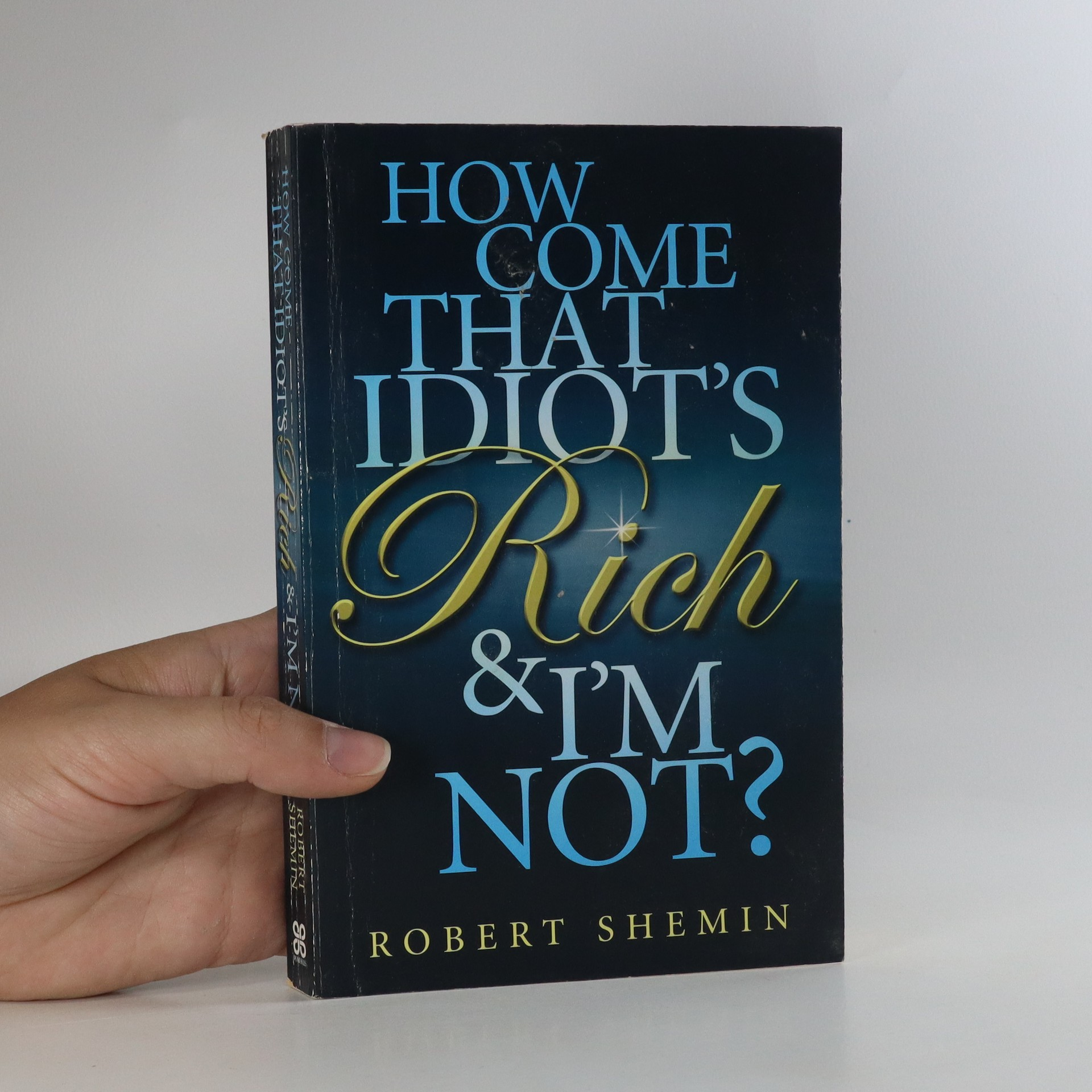 antikvární kniha How Come That Idiot's Rich and I'm Not?, 2009